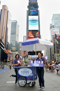 A Pleasure Cart hits Times Square, distributing vibrators to the teeming tourist masses.