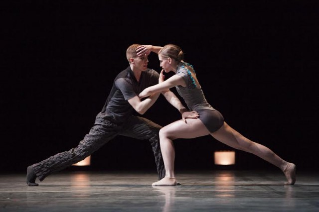 Pacific Northwest Ballet corps de ballet dancers Andrew Bartee and Leah Merchant in the world premiere of Alejandro Cerrudo's Memory Glow, being presented as part of DIRECTOR'S CHOICE, March 14 – 23, 2014.  Photo © Angela Sterling.