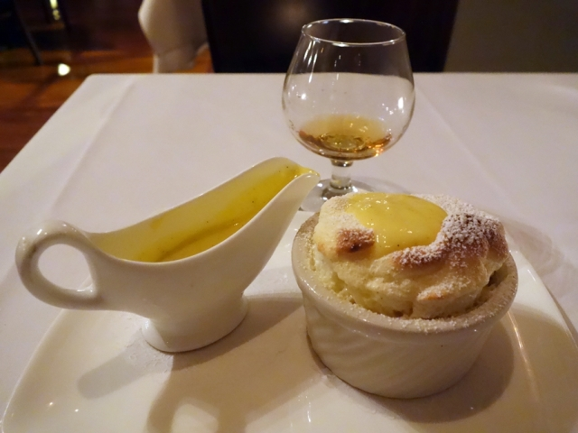 Grand Marnier soufflé, accompanied by Grand Marnier