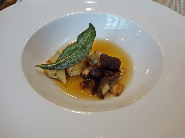Gnudi (made with ricotta piped into semolina) with pickled and seared artichoke hearts, maitakes, and mushroom catsup