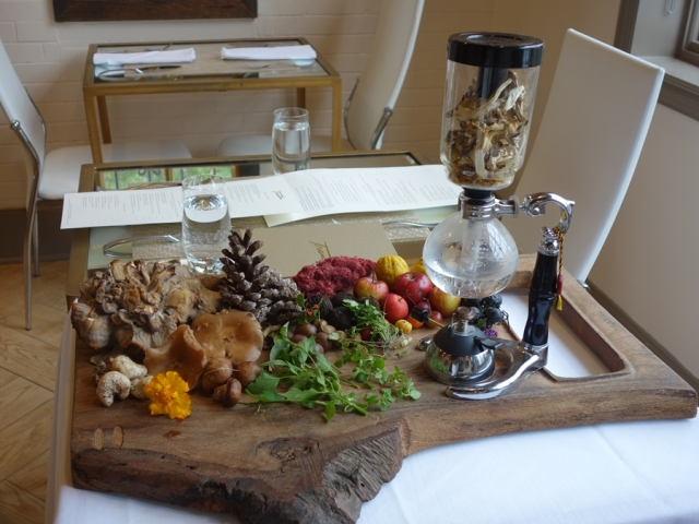 Foraged food (including mushrooms in a siphon) greets me at Trentina