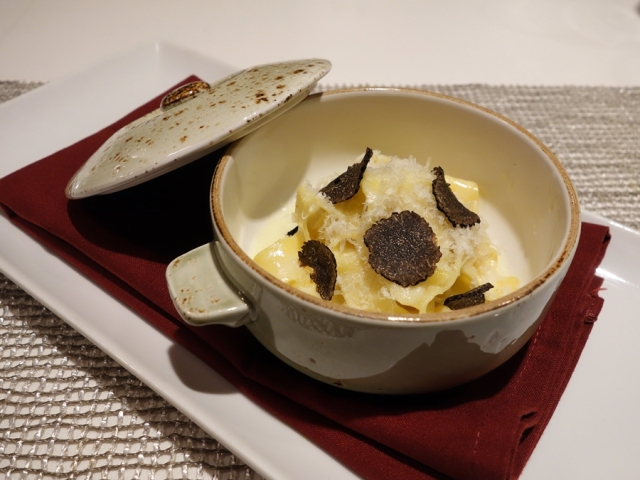 Pappardelle pasta with white truffle cream, grana padana, and shaved truffle