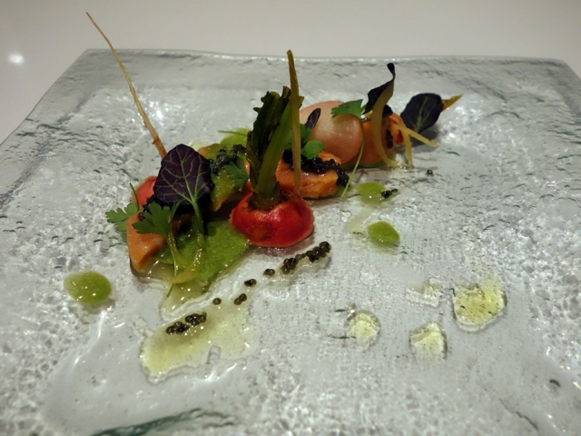 Citrus-cured salmon with pickled radish, cilantro emulsion, and sturgeon caviar