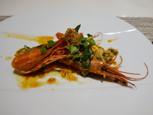 Chili-lemongrass spot prawns with cara cara orange, basil, and roe