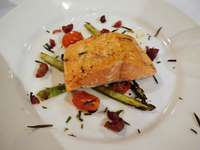 Seared Alaskan king salmon with asparagus and tomato salad, pancetta lardons, fried rosemary, Bormane Rivera Italian evoo, and 25-year Oro di Reggio Emilia balsamic vinegar, served with pecorino polenta
