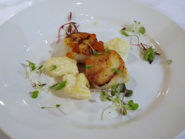 Semolina-dusted New England scallops with Gothberg Farms chevre gnudi, micro greens, and salmon roe (favorite dish of the night), served with creamy morel buttered English peas with thyme
