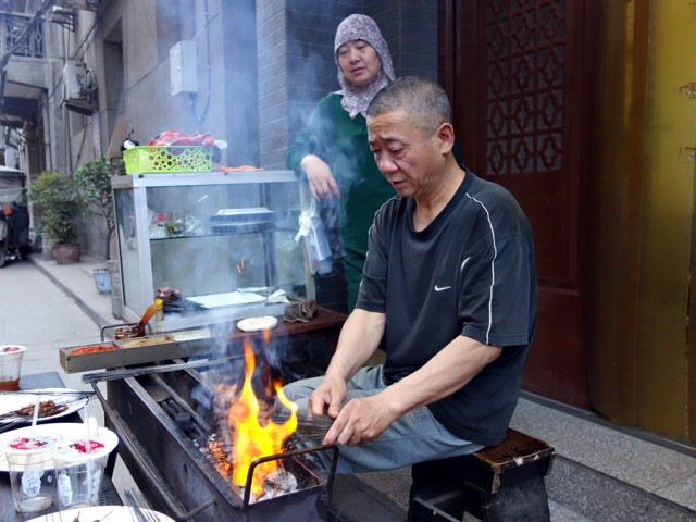 Grilling beef skewers on a fairly quiet street in the Muslim Quarter