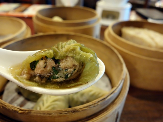 Inside a steamed dumpling with minced pork and basil at at Dian Shui Lou