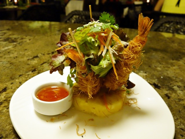 Ko's Tangled Tiger Prawns: shredded phyllo-wrapped tiger prawns, Kula greens, pineapple sweet chili garlic sauce and macadamia nuts