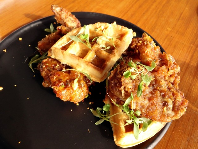 Migrant's KFC Chicken and Waffles: Hawaiian vodka-battered Korean fried chicken wings, Belgian waffles, umami butter, and roasted kim chee peanuts