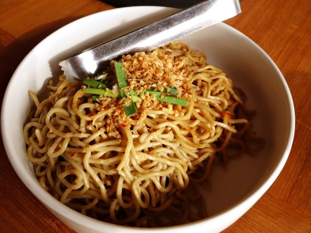 "I thought we ordered the ""Ay Kudesh! Garlic Noodles"" (pan-fried Iwamoto saimin noodles, insanely spicy Hawaiian chili pepper sambal, garlic three ways, and garlic chives), but this may have been the less spicy version. Still, a delicious dish with lots of layers of garlic."