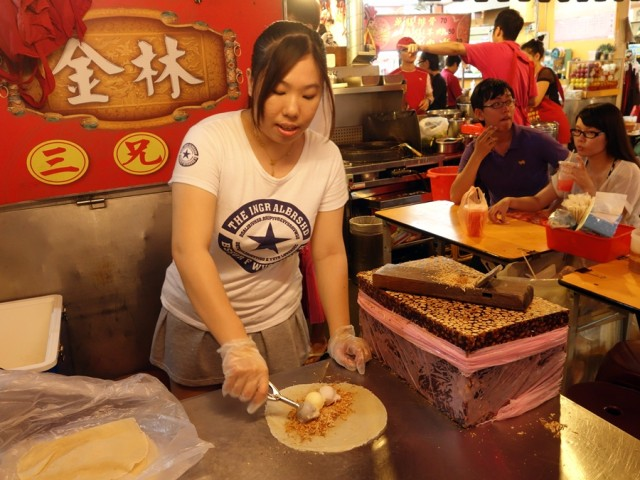 Making the ice cream crepe at Raohe Street Night Market