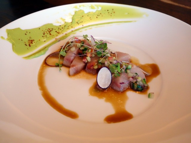 A treat from the Star Noodle kitchen: hamachi crudo with cucumber relish and yuzu ponzu, plus lemon avocado and Korean pepper on the side