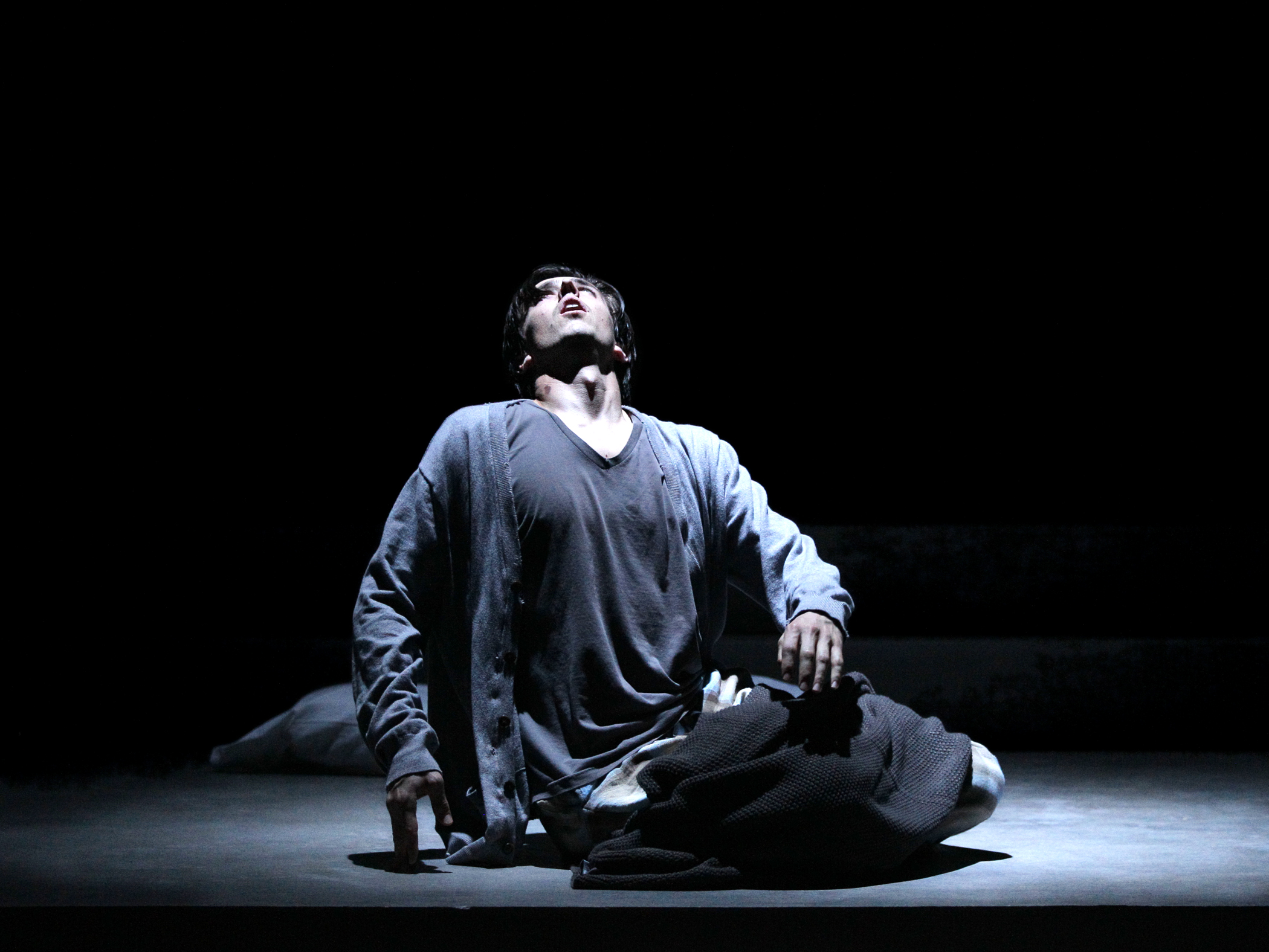 Prior Walter (Adam Stanley) has a divine encounter in Intiman's Angels In America, Part 1: Millennium Approaches